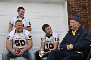 Members of S. Iredell football team chat with Steve.  Photo courtesy of Statesville Record & Landmark