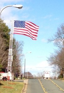 As a sign of respect, a huge American flag was stationed at the entrance of the The Park Huntersville.