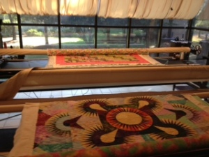 """Rebecca's workroom with two quilts """"in the works""""."""