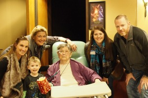 Amy with (clockwise from left) her grandson, daughter-in-law, nurse Cheryl, social worker Catherine, and her son